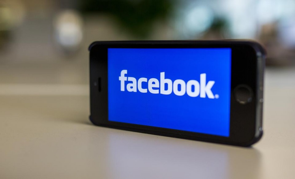 ILLUSTRATION - the illustration picture shows the logo of facebook on an iPhone 5s in Berlin, Germany, 31 October 2014. Photo by: Lukas Schulze/picture-alliance/dpa/AP Images